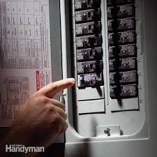 Man operating circuit breaker panel